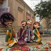 2019Amazing!穿越古絲路上的中亞五國之旅(9-3)--烏茲別克斯坦之希瓦內城:21●沒仔細看不知道,這些插隻木桿不知什麼作用的半成品原來是木偶造型之前的頭 (1).JPG